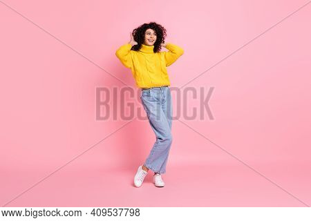 Full Length Photo Of Shiny Sweet Curly Woman Wear Yellow Pullover Standing Arms Hairdo Empty Space I
