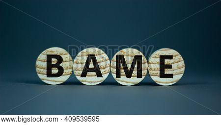 Bame Symbol. Abbreviation Bame, Black, Asian And Minority Ethnic On Wooden Circles. Beautiful Grey B