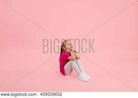 Dreamful. Childhood And Dream About Big And Famous Future. Pretty Little Girl Isolated On Coral Pink
