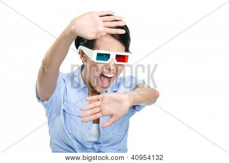 Scared girl in 3D glasses watches film and covers herself with hands, isolated on white
