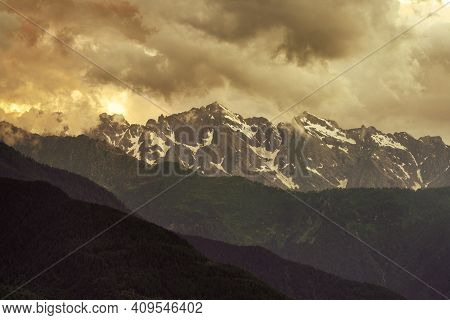 Tirano, Sondrio Province, Valtellina, Lombardy, Italy: Panoramic View Of The Mountains At Evening