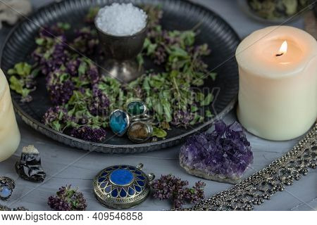 Magic Altar With Mystical Herbs, Salt, Candles And Crystals. Witch Sanctuary Sacred Esoteric Concept