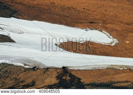 Top View To Beautiful Small Glacier, Meltwater And Mosses In Stony Mountain Side Close-up. View From