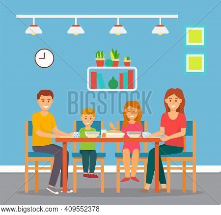 Family Of Four Sits In Dining Room Or In Kitchen And Has Lunch Or Breakfast. Plates With Food On The