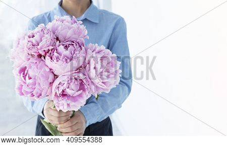 Big Beautiful Bouquet Og Pink Peonies In Boys Hands, Lots Of Copy Space. Greeting Concept. Congratul