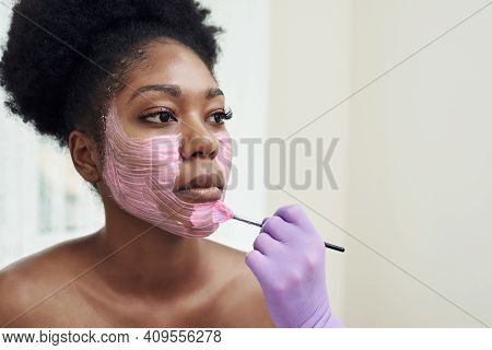 Spa Beauty Treatment, Skincare. Woman Getting Facial Care By Beautician At Spa Salon. Young Cosmetol