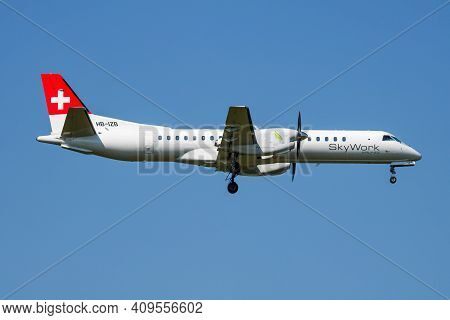 Vienna, Austria - May 13, 2018: Skywork Airlines Saab 2000 Hb-izb Passenger Plane Arrival And Landin