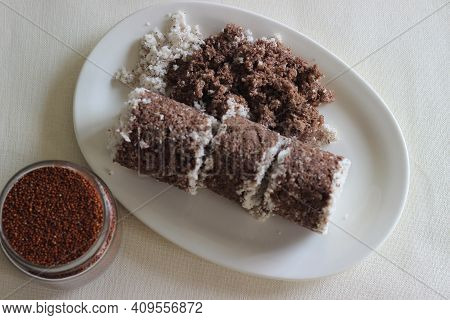 Steamed Finger Millet Cake. Made With Finger Millet Flour Combined With Grated Cocunut And Steamed I