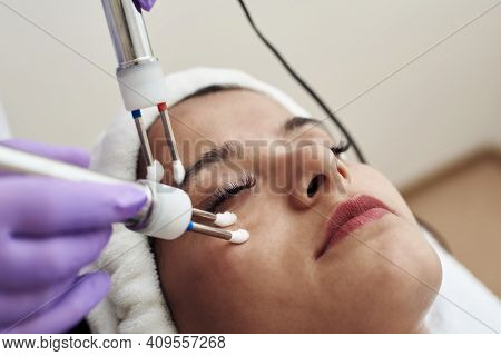 Beautician Using Electrical Impulses For Healthy, Firm, Toned Skin. Microcurrent Medicine Treatment.