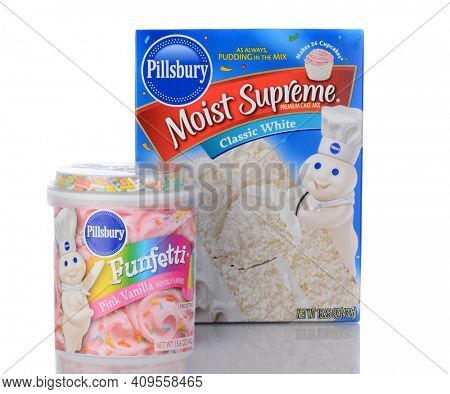 IRVINE, CA - January 05, 2014: Pillsbury Moist Supreme Cake Mix and Funfetti Frosting. One box of White Cake Mix and a can of ready to spread Funfetti Pink Vanilla Frosting.