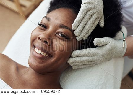 Facial Massage With Gloves With Microcurrents. Microcurrent Therapy. Cosmelotologist Makes Stimulati