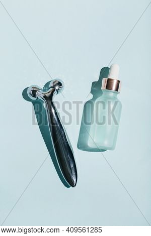 Beauty Product For Face Massage On Blue Background. Flat Lay, Top View