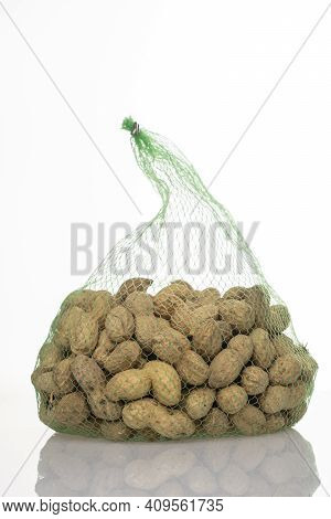 Peanuts In A Mesh Bag On A White Background, Organic Peanuts Isolated On A White Background Front Vi