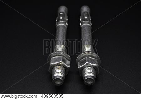 Galvanized Steel Metal Dowel With Metric Bolt And Nut, Isolated On Black Background