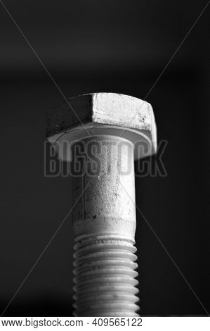 Galvanized Steel Metal With Metric Bolt, Isolated On Black Background