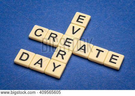 create every day - inspirational crossword in ivory letter tiles against textured handmade paper, creativity and personal development concept