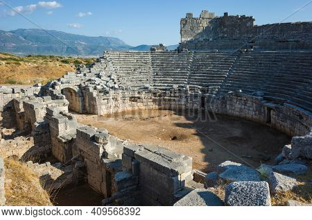 Ruins of Theatre in Xanthos Ancient Lycia City, Turkey. Sunny day, Old Lycian civilization heritage architecture amphitheater