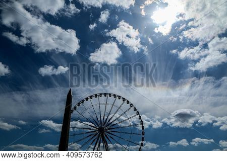 A Picture Of A Silhouette Of The Ferris Wheel And Obelisk At Place De La Concorde At Paris.