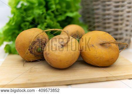 Fresh Yellow Turnip Fruits On A Wooden Board.