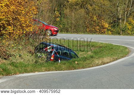 The Car In The Ditch By The Road After The Traffic Accident. Abandoned And Waiting For Tow.