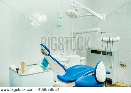 An Empty Chair In The Dentist's Office. Empty Dentist's Office