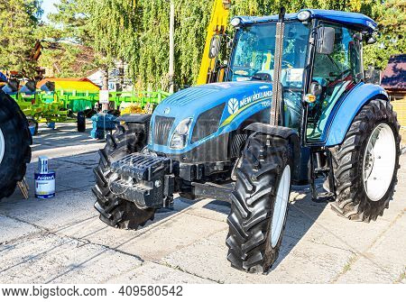 Samara, Russia - September 23, 2017: Modern Agricultural Wheeled Tractor New Holland Exhibited At Th