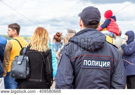 Samara, Russia - September 10, 2017: Russian Police Officer Against The Crowd At The City Street. Te
