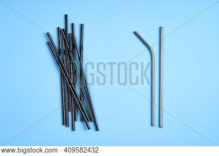 The Modern Trend Towards Caring For The Environment. A Pack Of Black Plastic Beverage Straws Versus