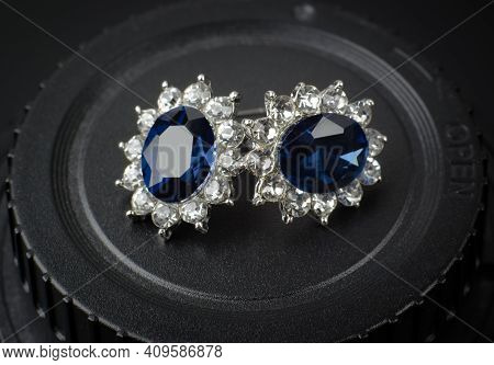 Silver Earrings With Blue Stone. Bijouterie Earrings Close Up