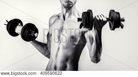 Skinny Guy Hold Dumbbells Up In Hands. A Thin Man In Sports With Dumbbells. Weak Man Lift A Weight,