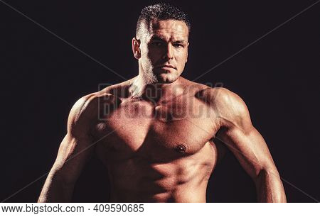 Showing Muscular Torso. Portrait Of Strong Healthy Handsome Athletic Man. Strong Athletic Man Showin