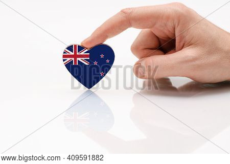 New Zealand Flag. Love And Respect New Zealand. A Man's Hand Holds A Heart In The Shape Of The New Z