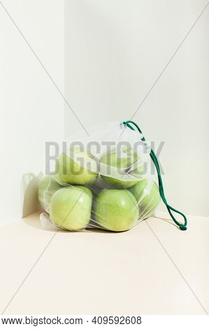 Reusable Packaging Of Products By Weight. Apples In A Reusable Bag Close Up On A Pink Background. Is