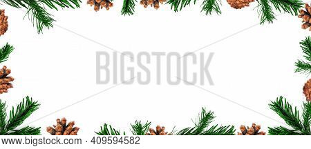 New Year And Christmas Isolated Border. Fresh Green Fir Tree Branches And Pine Cones Isolated On Whi