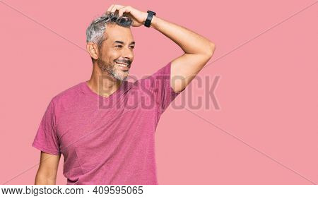 Middle age grey-haired man wearing casual clothes smiling confident touching hair with hand up gesture, posing attractive and fashionable
