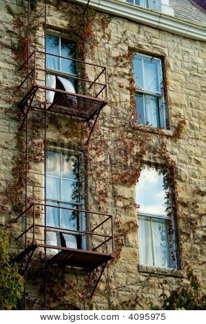 Fire Escape With Billowing Curtains