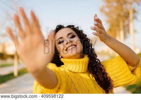 Makes Hands Of The Gym Movement Qigong In The Autumn Park Smiling Girl In A Bright Yellow Sweater. H