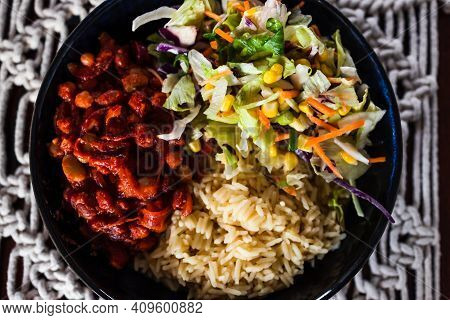 Healthy Plant-based Food, Vegan Nourish Bowl With Bean Chilli Sauce, Rice And Mexican Coleslaw Salad