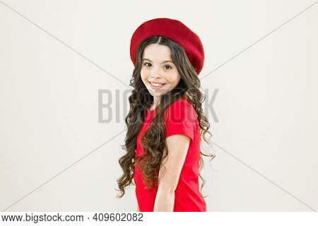 Parisian Child On Yellow Background. Summer Fashion And Beauty. Happy Girl With Long Curly Hair In B