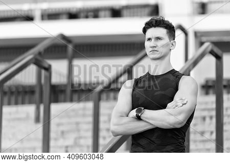 Muscular Young Man. Workout Routine. An Athlete Is Resting Tired After Training. Sport Watch On Hand