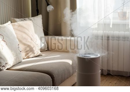 Modern Air Humidifier, Aroma Oil Diffuser At Home. Improving The Comfort Of Living In A House, Impro