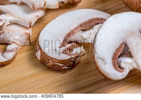 Royal Champignons, Parisian Champignons, Chopped Mushrooms On Bamboo Wooden Chopping Board, Close-up