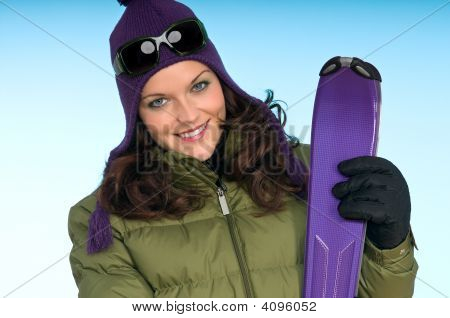 Fashion Model With Purple Skis