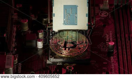 Bitcoin Btc And Cpu Central Processor On The Digital Technology Pc Motherboard. Mining, Market Tradi