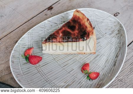 Basque Burnt Cheesecake With Strawberry Made With Sweetened Cream Cheese And Eggs And Cream Baked In
