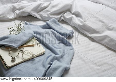 Composition With Soft Cashmere Sweater On Bed At Home, Space For Text