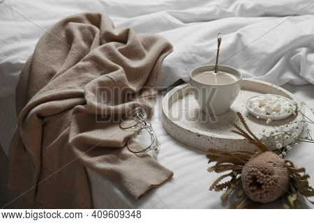 Composition With Soft Cashmere Sweater On Bed At Home