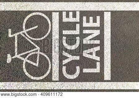 Cycle Lane Painted On Road With Bicycle Icon , Lane Reserved For Bicycle Movement.