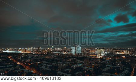 A Dark Evening Overcast Cityscape: Aerial View From A Drone Of A Night Urban Cityscape With The Deep