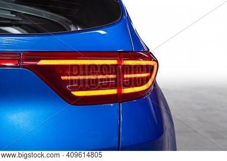 The Back Of A Blue Expensive Crossover Car:  Bumper, Trunk Lid, Taillight On The Back White Backgrou